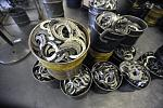 Horseshoes made of aircraft aluminum wait for the next step in their production journey at Thoro'Bred Inc. of Anaheim. Eventually they will be worn by race and competition horses worldwide.